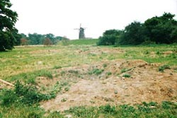 Windmill, dyke and shell crater on the area of Hatfield that represented Holland.